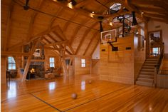 Lots of people have basketball hopes on their garages, letting them play some driveway hoops, but these homes have full-fledged indoor basketball courts. Home Basketball Court, Basketball Bedroom, Basketball Is Life, Basketball Tips, Indiana Basketball, Basketball Quotes, Basketball Scoreboard, Basketball Academy, Basketball Legends