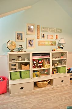 to aid in toy rotation system....less toys on the shelf and more decor. i love the globe, the lamp and the mr. potato head on the shelf instead of in a box.