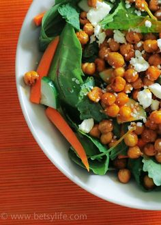 This Buffalo Chickpea Salad recipe is not only healthy for you, but also quick and easy to prepare and extra flavorful—a perfect meal for a busy weeknight. Made with roasted chickpeas, cucumber, carrots, and feta cheese, this savory dinner recipe is one to remember!