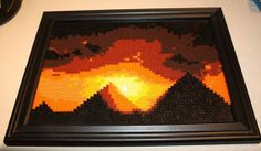 "Perler Egyptian Pyramids at Sunset. This is an original framed perler bead rendition of the three pyramids of Giza at sunset. There are approx 3500 beads total in this picture. Dimensions are 10""x13"" by SandCbeadworks on Etsy"