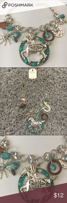 Cowgirl Necklace and Earrings Set NWT🎈🎁 New with tags earrings and necklace set. The earrings are small turquoise rocks with a fish hook. Clasp closure. Jewelry Necklaces