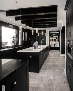 34 Admirable Luxury Kitchen Design Ideas You Will Love - When choosing the right luxury home plan, many to-be homeowners often get hung up on the kitchen details. Should there be a separate breakfast nook? Black Kitchen Cabinets, Kitchen Cabinet Design, Black Kitchens, Interior Design Kitchen, Home Kitchens, Dark Cabinets, Interior Decorating, Hallway Decorating, Kitchen Ideas With Dark Brown Cabinets