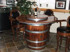 reese's custom pieces has created new eco friendly, green business taking retired oak wine barrels and creating custom furniture for you. We make Old World Style with a Fresh New Finish. Wine Barrel Table, Wine Tasting Room, Granite Slab, Old World Style, Liquor Cabinet, Custom Furniture, Rustic Style, Home Projects, Household
