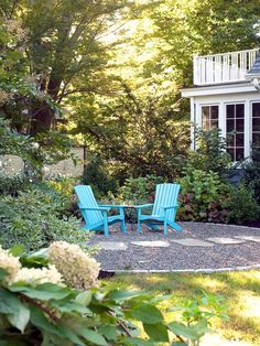 For subtle contrast these colorful Adirondack chairs stand out against grey gravel and green shrubbery. Photo courtesy of Westover and Photography by Rich Pomerantz