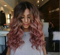 Woman with rose gold hair and brown roots