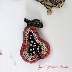 A personal favorite from my Etsy shop https://www.etsy.com/listing/528881924/crystal-pear-fruit-beads-brooch-unique