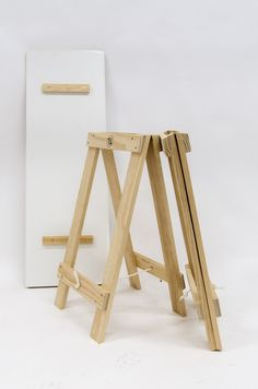 Malemine covered plywood table top sits inside the trestle leg