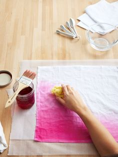 Dip a sponge in the clear chemical water. With short strokes, use it to wick the dye across the napkin. Let the dyed napkin rest on the wax paper for 3 hours. Rinse in cold water, then hot water, until excess dye is removed.   - CountryLiving.com