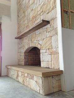 Fireplace With Built In Wood Storage Niches And Rough Hewn