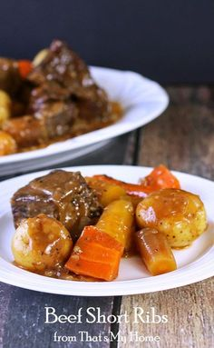 Beef Short Ribs with Rainbow Carrots and Baby Potatoes, smothered in gravy.