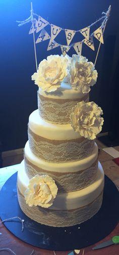 Ivory, lace, burlap and peony wedding cake.