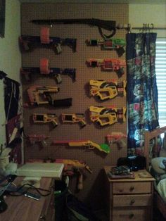 Nerf gun storage solution with a peg board. Boys Room Decor, Boy Room, Nerf Gun Storage, Camo Rooms, Nerf Party, Army Party, Storage Organization, Organization Ideas, Storage Ideas