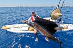 Massive sailfish caught from a paddle board. Unbelievable!