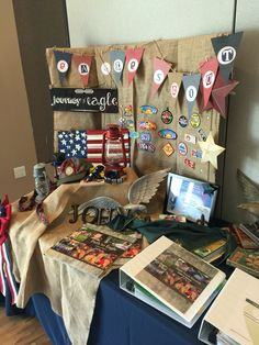 Display table at my son's Eagle Court of Honor. In addition to his achievement books, I included antique and vintage scout books...fun to look through!