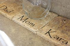 Personalized coasters lined up on the kitchen counter to keep track of whose glass is whose. Maybe this will cut down on the dishwasher loads of glasses and cups!