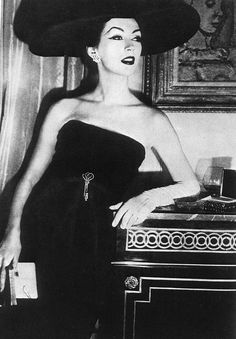 Dovima wearing black strapless cocktail dress by Dior, Spring 1956