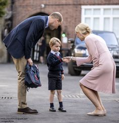 Prince George, with dad the Duke of Cambridge looking on, is greeted by the Head of the Lower School, Halen Haslem, Thomas's Battersea, September 7, 2017
