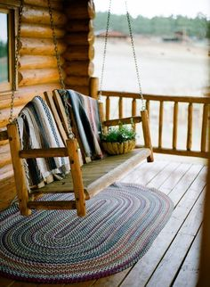 Log cabin porch and swing.