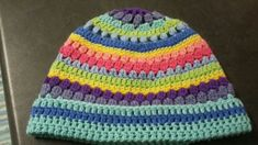 This beanie was made for my godchild Holly. It fits a young teen, but can be adjusted to fit a child or adult by adjusting the hook size.