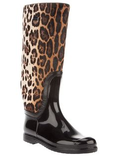 LEOPARD BOOT . LEATHER . Black leather boot from Dolce and Gabbana featuring a round toe, leopard print design on the leg of the boot, with a ridged sole, and a silver metallic plate featuring the design logo.
