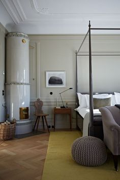 Neutral scheme with four poster bed in Modern Contemporary Bedrooms. A modern bedroom inspired by Scandinavia with grey walls, four poster bed and tiled stove. Italian Interior Design, Best Interior, Home Interior, Luxury Interior, Swedish Design, Bedroom Furniture, Bedroom Decor, Bedroom Ideas, Design Bedroom