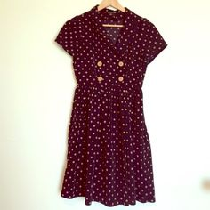 """Navy polka dot dress Navy blue dress with tan polka dots. Has a double breasted like chest. Length: 35"""", waist: 28"""" Forever 21 Dresses Mini"""