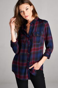 The perfect fall plaid in a navy/wine color scheme. This rayon twill plaid top has two flap chest front pockets and roll tab sleeves with a snap button closure. 100% Rayon.
