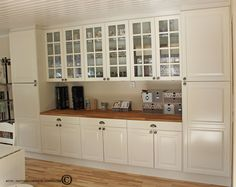 This would be great, maybe on a slightly smaller scale for the dining room wall. Flanking pantry cabinets. Would/could I make a beverage bar/area for coffee and all stemware?