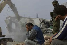 Palestinian man very upset to watch his home destroyed by Israeli soldiers