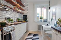 small kitchen - subway tile + wooden shelves