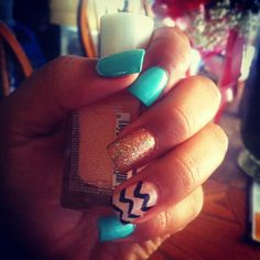 Teal, gold, and Chevron nails