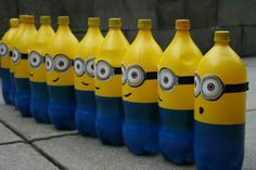 Minons bday....tie balloons to the top?? Excellent way to recycle 2liter soda bottles into cute minions for a despicable me party decorations.