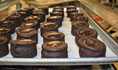 Chocolate molten lava cakes right out of the oven. Microwave for 30 seconds before serving to soften the center filling for a perfect first bite. #chicagodesserts #lavacake