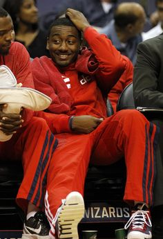 Washington Wizards guard John Wall sits on the bench during the third quarter of an NBA pre-season basketball game against the New York Knicks in Washington on Thursday, Oct. 11, 2012. Wall is expected to miss the first month of the season after being diagnosed with the early stages of a stress injury to his left knee cap.
