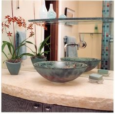 I used this sink, faucet, stone counter top and glass shelf in my powder room remodel 10 years ago.  Still love the look.