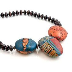 Discover this unique, nature inspired necklace designed by Loretta Lam. Made from polymer clay in the venetian Millefiori technique on a wood bead strand.  Measures 19''  Featured in DeYoung Holiday Gift Guide