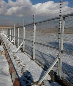 View of electrified fence in the snow. Perimeter Security, Tactical Truck, Underground Bunker, Wildlife Park, New Property, Property Management, Agriculture, Homesteading, Climbing