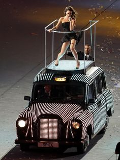 Victoria Beckham (Posh Spice) performs with the Spice Girls during the Closing Ceremony at the 2012 Summer Olympics, Sunday, Aug. 12, 2012, in London. (AP Photo/Ivan Sekretarev)