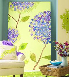 Turn an old sheet into a painting. Stamp tons of small flowers in a mix of colors until they grow into enormous blossoms. Then, secure the green-dyed twin sheet to a homemade wood frame like an artist's stretched canvas!
