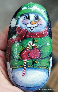 cute little snowman hand painted rock holiday decor