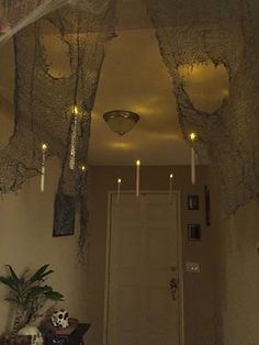 Floating candles in my front hallway. Front Hallway, Floating Candles, Halloween Decorations, Chandelier, Ceiling Lights, Home Decor, Candelabra, Decoration Home, Room Decor