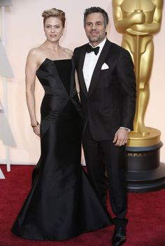 Red Carpet Watch: Oscars 2015 - NYTimes.com. Mark Ruffalo and his wife -- I think her name is Sunshine (yeah) Coigney. Her gown is beautifully elegant.
