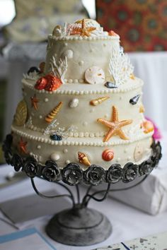 Strategically placed seashells make all the difference. Baker: Rosalie Joy's Bakery. Photo: Sierra Kristen Photography See more cakes at: http://realmaineweddings.com/Planning-Tools/Maine-Cakes.aspx