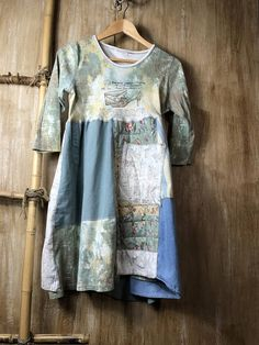 This up cycled dress is unique and one of a kind. The pastel colors are romantic and fun. Would be so great with skinny jeans or leggings! The top is a cotton knit T shirt very shabby chic and the bottom has a unique piece of quilting fabric for something different and soft. Has