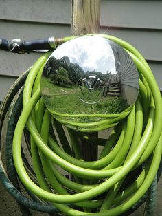 Hubcap Upcycled Into Garden Hose Guard