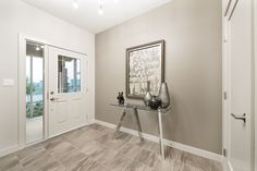Make the most out of the entryway to your home with a tight, minimalistic collection of accent pieces<br></a>as seen here in Jayman MasterBUILTs Allure showhome in Secord, Edmonton. New Home Designs, Accent Pieces, Oversized Mirror, Entryway, New Homes, Minimalist, Decor Ideas, House Design, Furniture