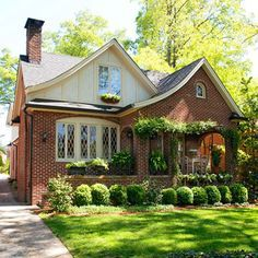 Brick Tudor Style Cottage...That's exactly the style of house I want one day :)  Preferably nestled in a historic neighborhood with lots of stately old trees <3