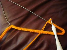 Crochet covered coat hanger-- I did this in primary a hundred years ago!