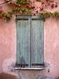 green shutters in the medieval town of Grimaud, Provence, France