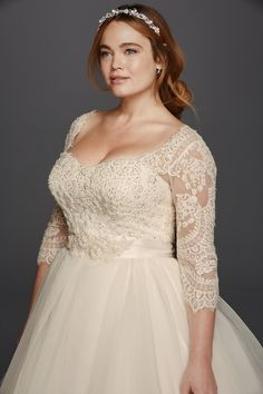 Oleg Cassini Plus Size three-quarter lace sleeves and a flattering sweetheart neckline organza ball gown wedding dress available at David's Bridal